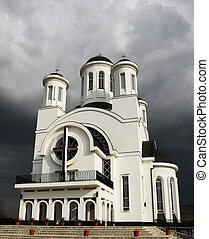 Church and approaching storm - Withe christian church and...