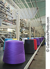 Textile Industry - Textile machine weaving with cone fiber...