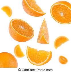 flying sliced orange fruit segments isolated on white...