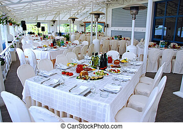 Tables at restaurant served for a banquet with meals