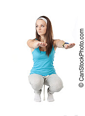 squatting girl - The image of squatting girl under the white...