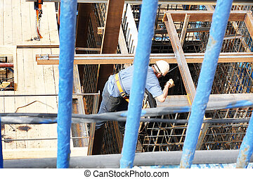 builder working on building