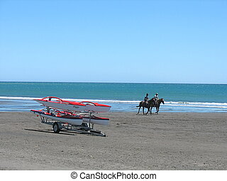 New Plymouth beach - Canoes and horse riders on beach