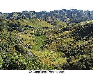 Forgotten World Highway - railway line through green valley,...