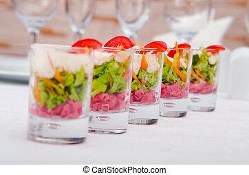 Vegetarian salad served in glasses