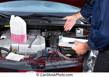 Auto mechanic. - Hands of mechanic working in auto repair...