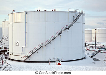 white tanks in tank farm with snow in winter - white tanks...