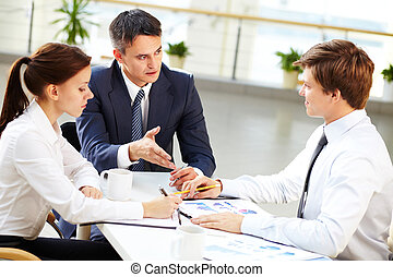 Discussion - Business leader and his employees discussing...
