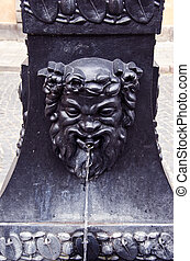 retro street fountain with mythological head - retro street...