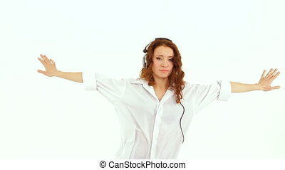 Girl dances on a white background