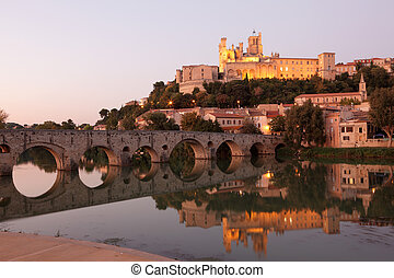 Cathedral and Pont Vieux at night Beziers, southern France