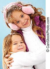 Siblings - Happy siblings looking at camera with smiles