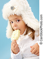 Cutie - Little girl in white furry hat looking at camera...