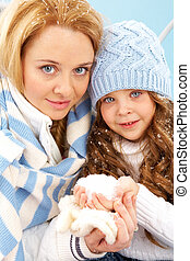 In winter - Portrait of mother and her daughter in winter...
