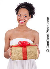 Young African American woman holding a gift box