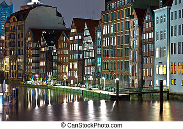 old townhouses at the canal in Hamburg by night - old...