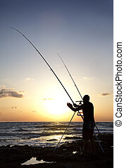 Silhouette of Man Fishing at Sunset - Fisherman silhouette...