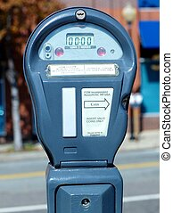 PARKING METER - A digital parking meter on a city street