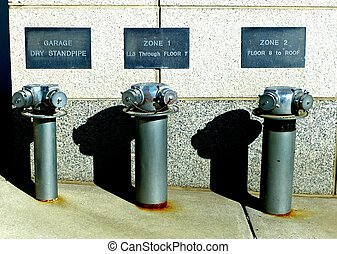 THREE STANDPIPES - Three standpipes in an urban setting