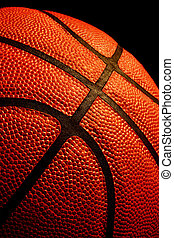 Basketball - Close up of a basketball isolated on black