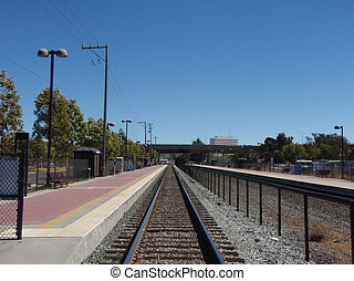 Commuter Train Tracks stretch into the distance in...