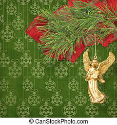 Angel christmas hanging on the pine branch.
