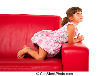 girl on red sofa