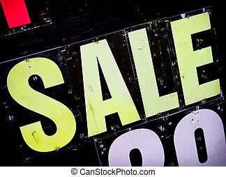 Sale sign on billboard