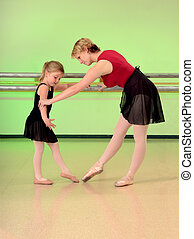 Ballet Teacher with Girl Dance Student - A Ballet Teacher...