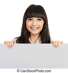 Happy smiling young business woman showing blank signboard,