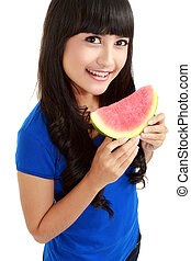 Woman ready to take a bite out of watermelon - Woman against...