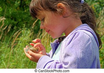 Girl and garden snail - observation garden snail on children...