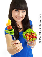 Pretty girl eating fruit salad, healthy fresh breakfast, dieting and health care concept. in isolated white background