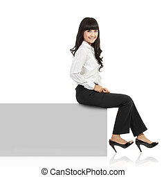 Woman smiling sitting on horizontal banner edge. Happy...