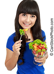 Pretty girl eating fruit salad, healthy fresh breakfast,...
