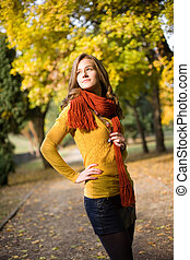 Dreamy fall fashion girl in colorful clothes. - Half length...