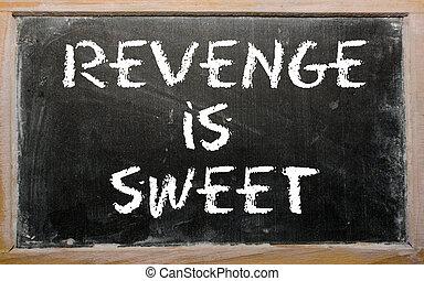 """Proverb """"Revenge is sweet"""" written on a blackboard"""
