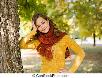 Colorful fall fashion girl in the park.