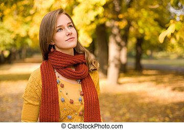Fall fashion girl pondering - Portrait of colorful fall...