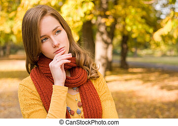 Fall fashion girl pondering. - Portrait of colorful fall...