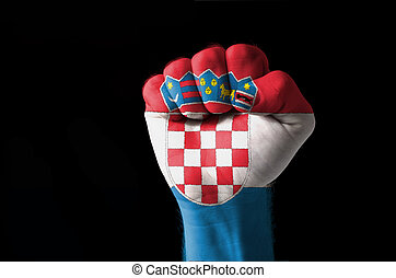 Fist painted in colors of croatia flag