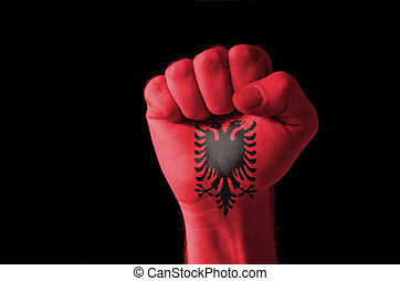 Fist painted in colors of albania flag