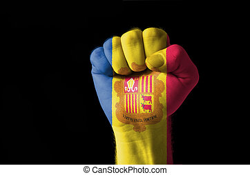 Fist painted in colors of andora flag - Low key picture of a...