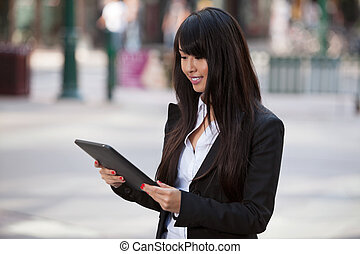 Businesswoman using tablet pc - Smiling business woman using...