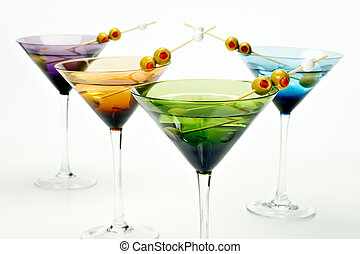 Martinis in colorful glasses - Four colorful martini glasses...
