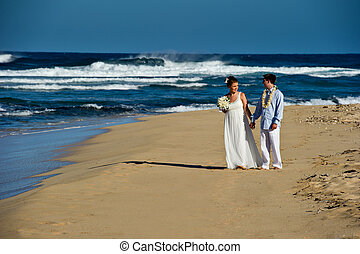 Just Married. Beautiful young couple on the beach.