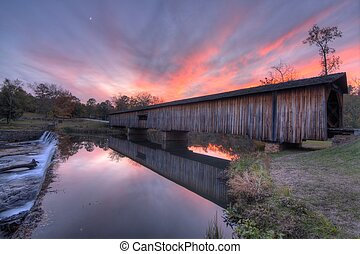 Watson Mill Covered Bridge in North Georgia, USA at dusk.