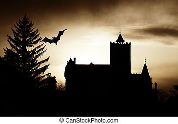 Dracula Castle scary scene at sunset and flying bat