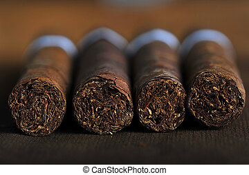 Cigars - Detailed photo of a cigar front. Very shallow DOF