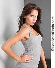 Brunette hottie - Portrait of fit slender young brunette...